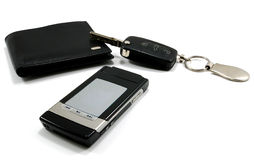 Black wallet car key mobile phone 1. Black wallet with car key and black fashionable mobile phone isolated on white Royalty Free Stock Photo
