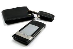 Black wallet car key mobile phone 3. Black wallet with car key and black fashionable mobile phone isolated on white Stock Photo