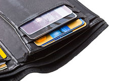 Black  wallet with credit cards close up isolated. Black leather wallet with credit cards close up isolated Royalty Free Stock Photography