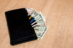 Black Wallet with credit cards and dollar banknotes Royalty Free Stock Photos