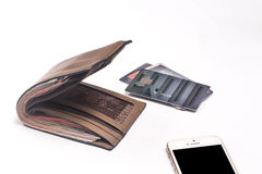 Black Wallet with credit cards and dollar banknotes over white b Stock Photography
