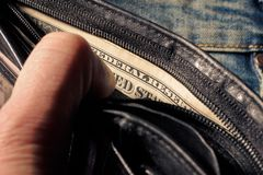 Black wallet with dollars in the hands royalty free stock images