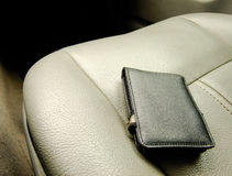 Black Wallet on the Front Seat Stock Photo