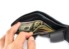 Hand looking for money in wallet on white background royalty free stock photo