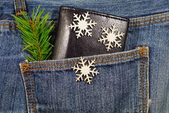 Black wallet in jeans pocket, money on Christmas gifts - Christmas shopping Stock Images