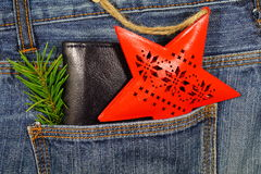 Black wallet in jeans pocket, money on Christmas gifts - Christmas shopping Royalty Free Stock Photography