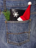 Black wallet in jeans pocket, money on Christmas gifts - Christmas shopping Royalty Free Stock Images
