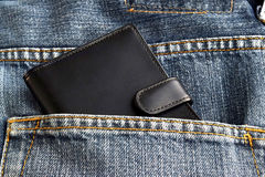 Black wallet in jeans trousers back pocket Royalty Free Stock Image