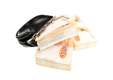 Black wallet with money stacks. Black wallet with stacks of russian fivethousand banknotes isolated on white background Stock Photos