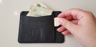 Black wallet with one yuan banknote in it royalty free stock image