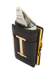 Black wallet with the pack of dollars. Royalty Free Stock Images