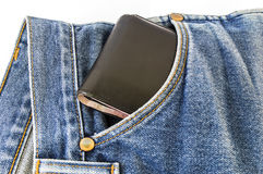 Black wallet in the pocket of jeans trouser Stock Photos
