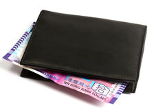 Black wallet with ten HK Dollars Royalty Free Stock Photography