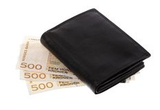 Black wallet on top Norwegian currency Stock Photo