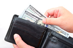 Black wallet with US dollars in the hands Stock Photography