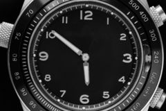 Black watch closeup. The black dial of the watch with the arab figures closeup show time 5-50 royalty free stock photos