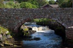 Black water under the bridge. Black water river flowing under a bridge, Isle of Arran, Scotland royalty free stock photos