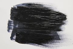 Black watercolor brush stroke over white background. Black watercolor brush stroke over white background royalty free stock images