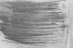 Black watercolor crayon on paper background texture. Black color watercolor crayon on paper background texture royalty free stock image