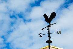 Black weathervane in the form of a rooster Stock Photos