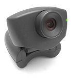 Black Webcam. A black USB Internet Webcam with red lens and green led light stock photos