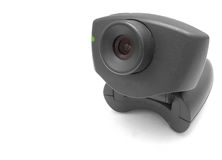 Black Webcam. A black USB Internet Webcam with red lens and green led light stock images