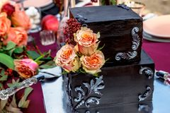 Black wedding cake with natural roses stock images