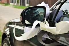 Black wedding car decorated with ribbon. Mirror of black wedding car decorated with ribbon Stock Images