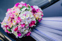 Black wedding car decorated with white roses Royalty Free Stock Photo