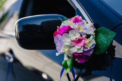 Black wedding car decorated with white roses Stock Images