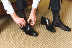 Black Wedding Shoes. Groom putting on black wedding shoes Stock Image