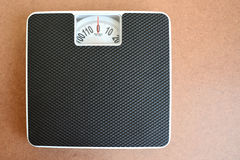 Black weight scale on wooden background. Stock Photography
