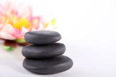 Black wellnes stones with deco Stock Photos