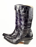 Black western boots. A new pair of black cowboy western boots with crocodile leather for women. Image taken in studio isolated on white background stock image