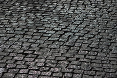 Black wet cobblestone Stock Photos