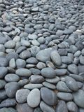 Black and wet pebbles Stock Image