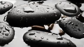 Black wet pebbles background Stock Photo