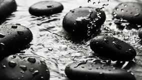 Black wet pebbles background Stock Photos