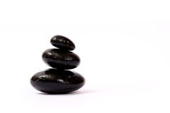 Black wet stones Stock Photography