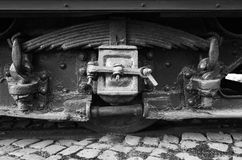 Black wheel and leaf spring of vintage tram Royalty Free Stock Photo