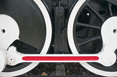 Black wheel of train with white and red mechanism Stock Photos