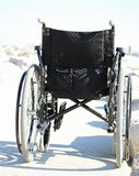 Black wheelchair from behind with rubber wheels Stock Photos