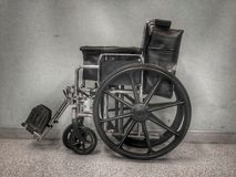 Black wheelchair. Royalty Free Stock Images