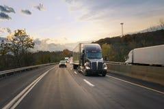 Black 18 wheeler highway Stock Image