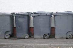 Black wheelie bins in a row on street stock images