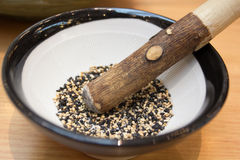 Black and white sesame in mortar and pestle. Black and whie sesame in mortar and pestle on the table Stock Photo