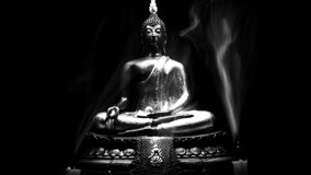 Black and whihte style of Buddha statue and Candle smoke with light dark background. Royalty Free Stock Image