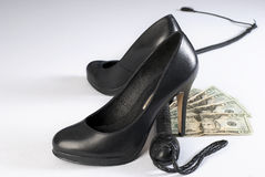 Black  whip, high hells shoes and money Stock Photography