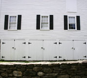 Black on White. Black shuttered 1700's New England carriage house clad in white siding Royalty Free Stock Images