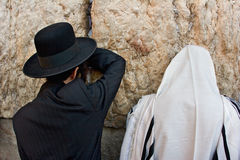 Black and White. Mens praying at the wailing wall Stock Photography